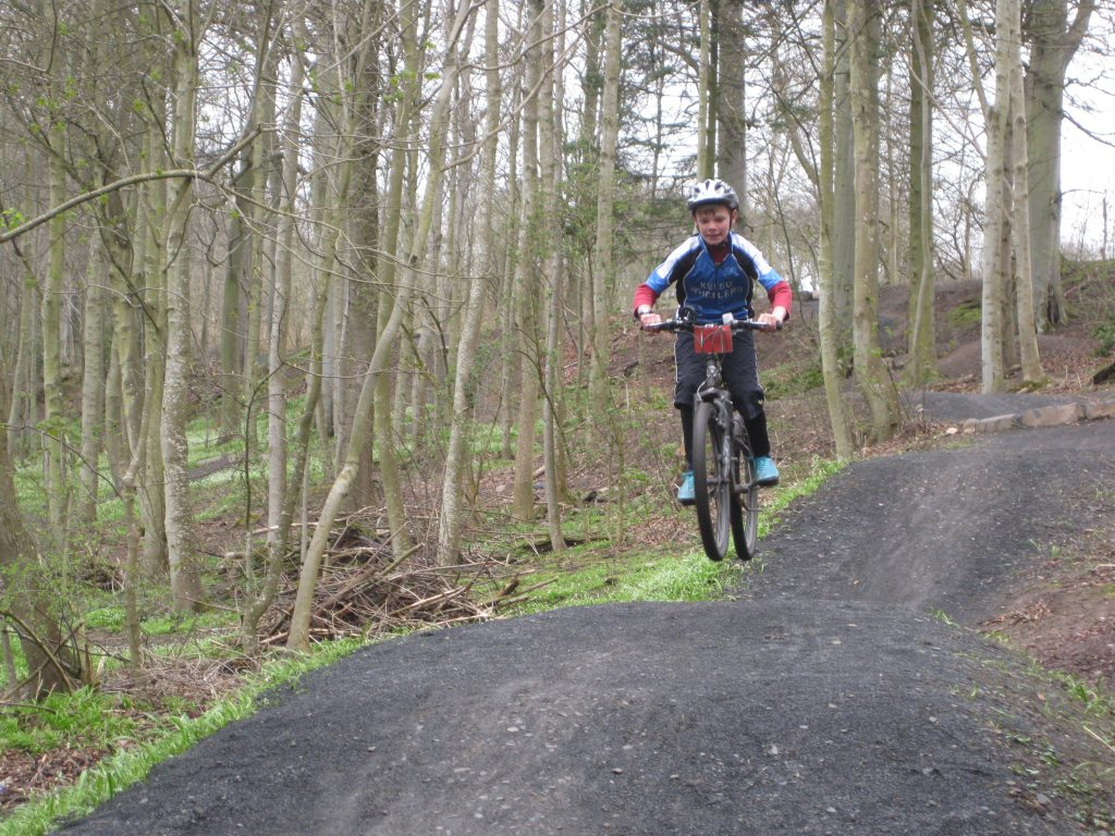 A cyclist jumping at Angraflat bike trail in Kelso.