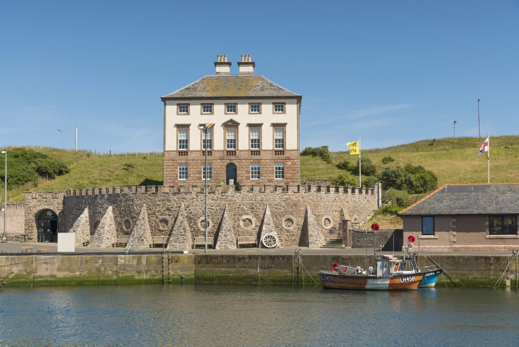 A view of Gunsgreen house from across the harbour.