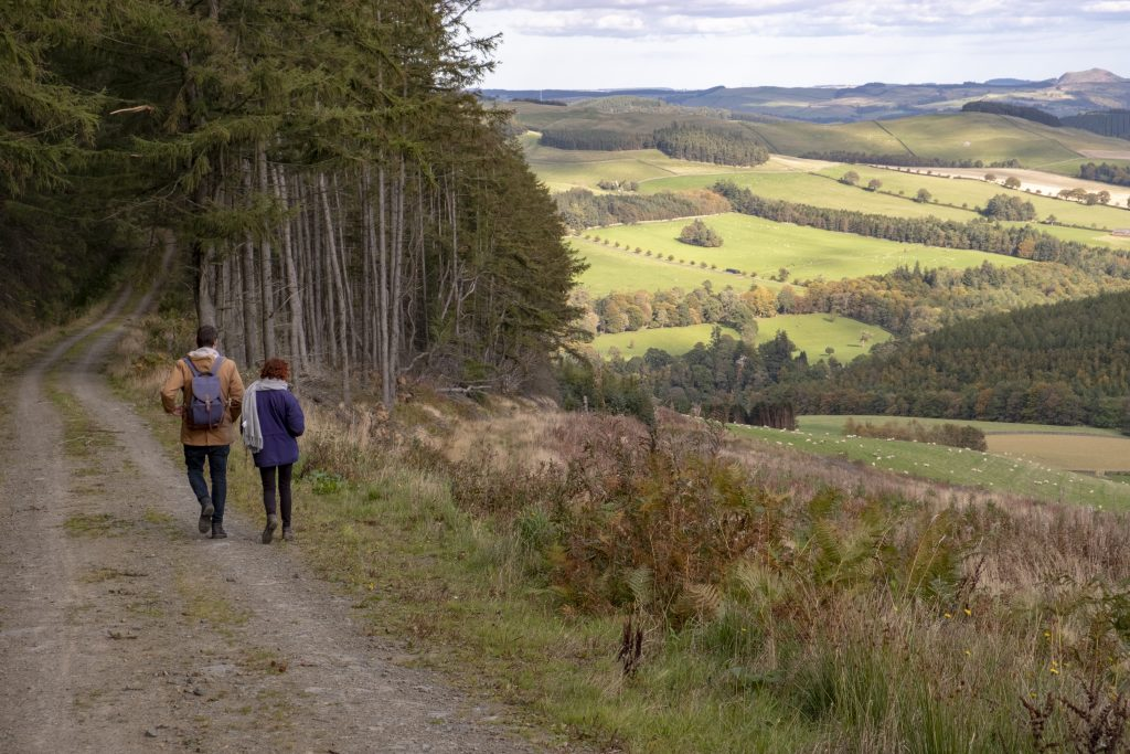 Two walkers in the Scottish Borders.